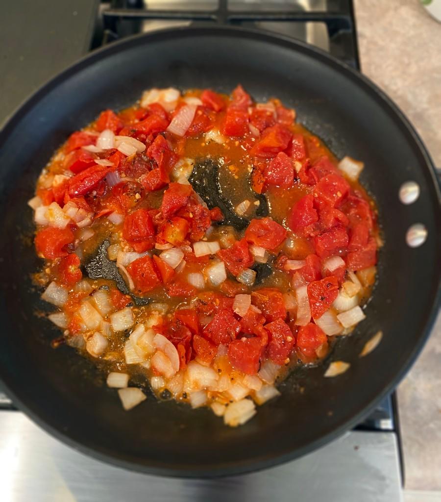 adding tomatoes